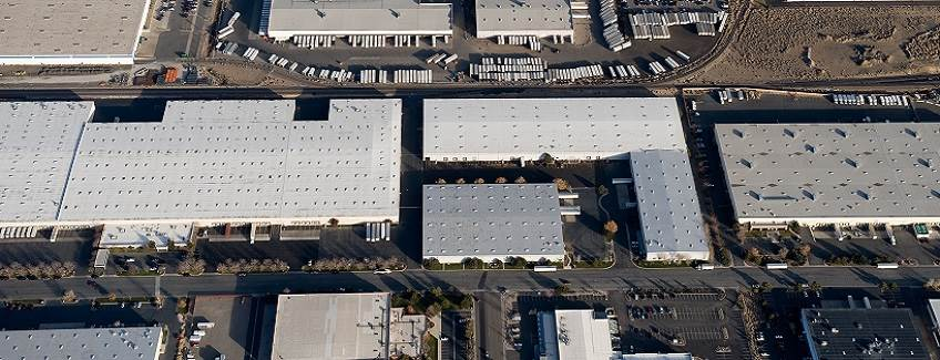Overhead view of commercial roofs in an industrial park.