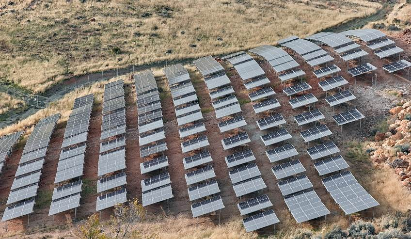 Solar panels along a hillside